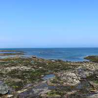 Seahouses foundations on the coastline of England