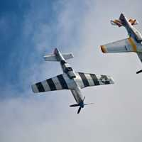Two P-51 Mustangs in an airshow