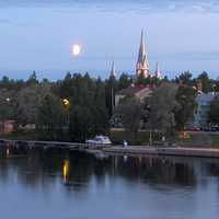 Church of Joensuu on the riverbank under the midnight sun in Finland