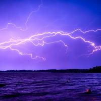 Lightning Across the sky over the water