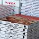 Bunch of Stacked Pizza Boxes