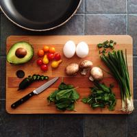 Cooking ingredients with avocado, mushrooms, and eggs