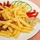 Fries on a plate with chicken and cucumbers