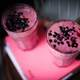 Glass of Pink yogurt with berries