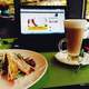 Latte and Sandwich on a table with laptop
