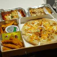 Pizza Box lunch with lasagna and chicken strips