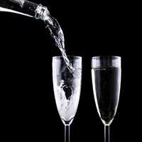 Pouring two cups of sparkling wine