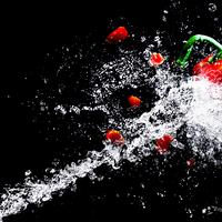 Water squirting on peppers