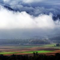 Beautiful Farm and Forest Landscape under the clouds in the French Alps