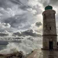 Lighthouse under sky and clouds at Marseille, France