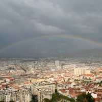 Rainbow over the cityscape of Marseille