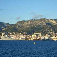 View of Toulon, the Arsenal and Mount Faron from the Harbour in France