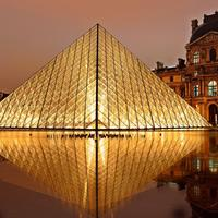 Pyramid of Louvre at night in Paris, France