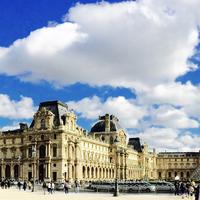 Panoramic of Paris under skies and clouds