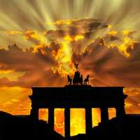 Brandenburg gate with rays of sunshine