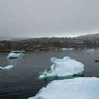 Boat among the Icebergs