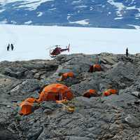 Tents and Helicopters on the Rocky Terrain in Greenland