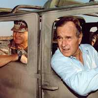 Norman Schwarzkopf, Jr. and President George H. W. Bush visiting troops during the Gulf War