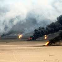 Oil well fires rage outside Kuwait City in 1991 in the Gulf War