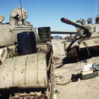 Two Iraqi tanks lie abandoned near Kuwait City in Gulf War