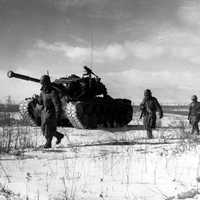 A column of the U.S. 1st Marine Division move through Chinese lines, Battle of Chosin Reservoir