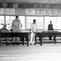Delegates sign the Korean Armistice Agreement in P'anmunjŏm