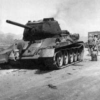 Destroyed T-34 Tank along the road during the Korean War