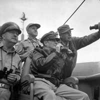 General Douglas MacArthur, observes the naval shelling of Incheon during Korean War