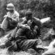 G.I. comforting a grieving infantryman in Korean War