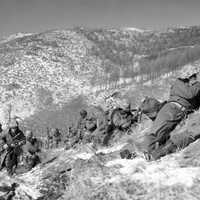 Marines taking cover at the Battle of Chosin Reservoir, Korean War
