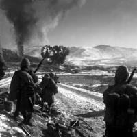Marines watching explosions to flush out enemies, Korean War