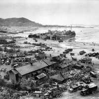 Tank landing Ships unload men at Inchon during the Korean War