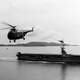 US Navy Sikorsky HO4S flying near USS Sicily during Korean War