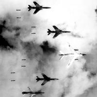 B-66 Destroyer and four F-105 Thunderchiefs dropping bombs in the Vietnam War