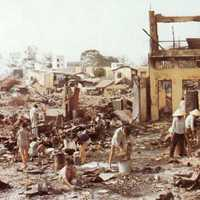 Civilians sort through the ruins of their homes in Cholon in the Vietnam War