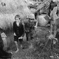 Marine from 1st Battalion, 3rd Marines, moves an alleged Viet Cong activist in Vietnam War