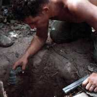 Tunnel Rat Soldier entering a Vietcong Tunnel during the Vietnam War