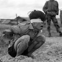 Viet Cong prisoner captured in 1967 by the U.S. Army awaits interrogation during Vietnam War