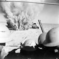 A mine explodes close to a British artillery tractor during 2nd battle of El Alamein