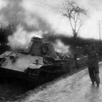 American Soldier escorting German  Crewman from burning Panther Tank during the Battle of the Bulge