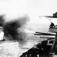 Battleship USS New York firing on Iwo Jima during World War II
