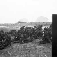 British troops take cover after landing on Sword Beach during D-Day, World War II
