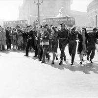 Civilians and service personnel in London celebrating V-J Day in England