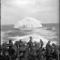 Depth charges detonate astern of the Sloop HMS Starling in World War II