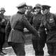 German and Soviet army officers pictured shaking hands After the division of Poland, World War II
