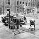 German women washing clothes at a cold water hydrant in a Berlin street, World War II