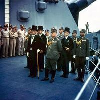 The Japanese representatives aboard the USS Missouri signing Surrender Document