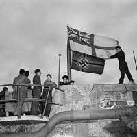 Seamen raise the White Ensign over a captured German U-boat in World War II