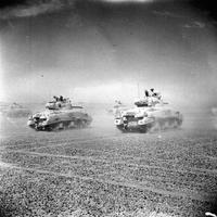 Sherman tanks of the eighth Army move across the desert at the Second Battle of El Alamein