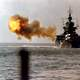The battleship USS Idaho shells Okinawa in World War II